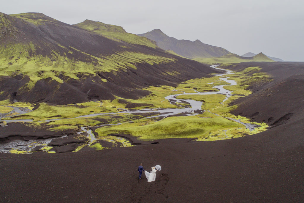 Cameron and Beau Adventuring in the Icelandic Highlands on their wedding day shot via drone