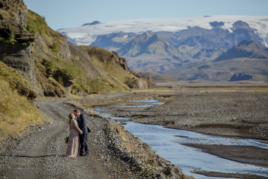 Couple walking down a road within Thorsmork on their Iceland Wedding Day