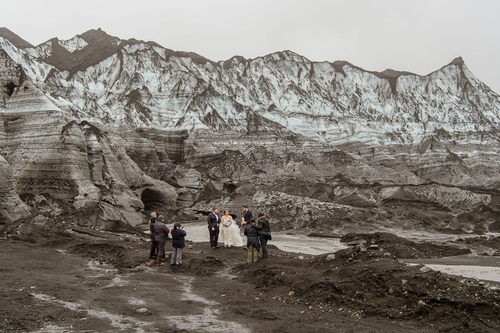 Small Wedding Ceremony in font of a glacier in Iceland