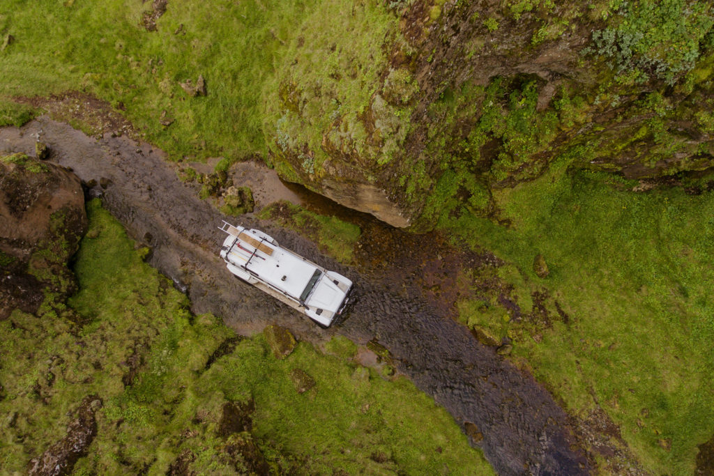 White Land Rover Crossing a River in Iceland