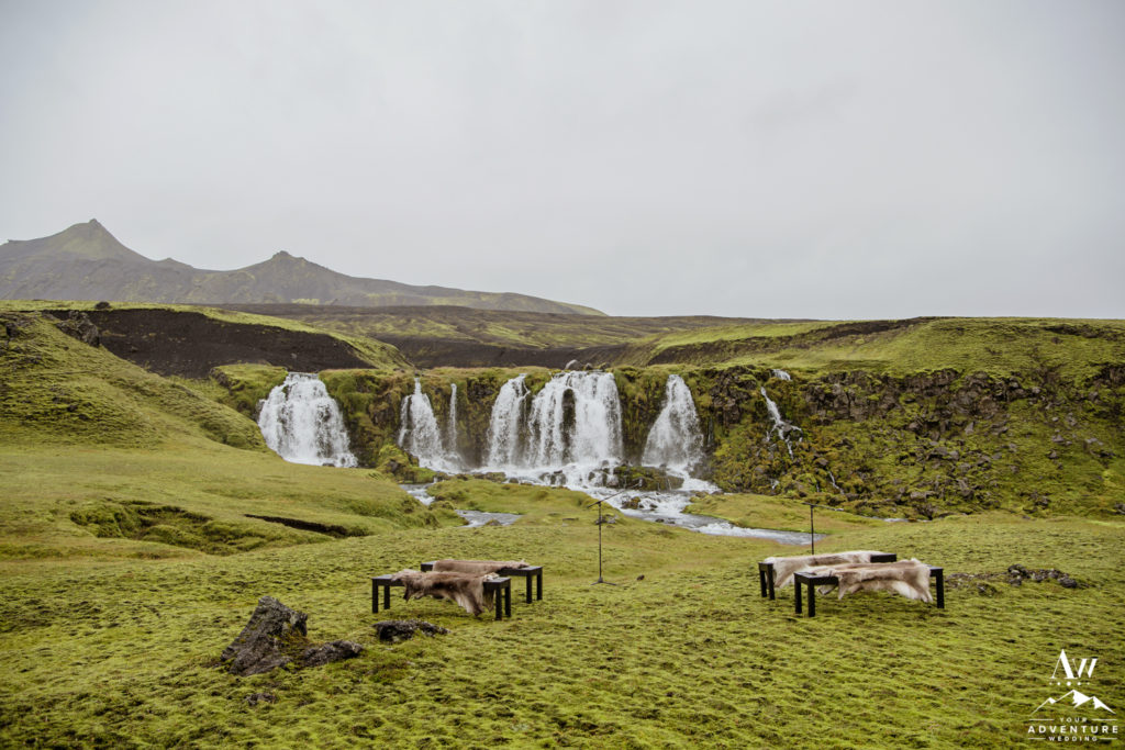 Benches with Furs in front of a Secret Waterfall for an Iceland Wedding