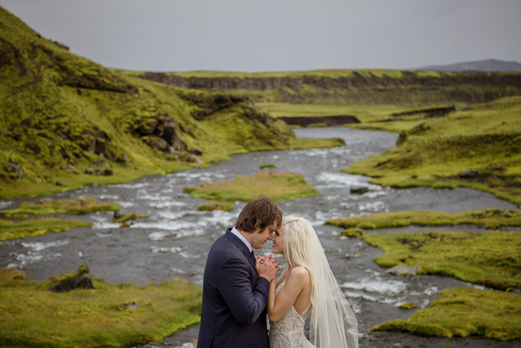 Cameron and Beau being romantic on their Iceland wedding day in front of a canyon