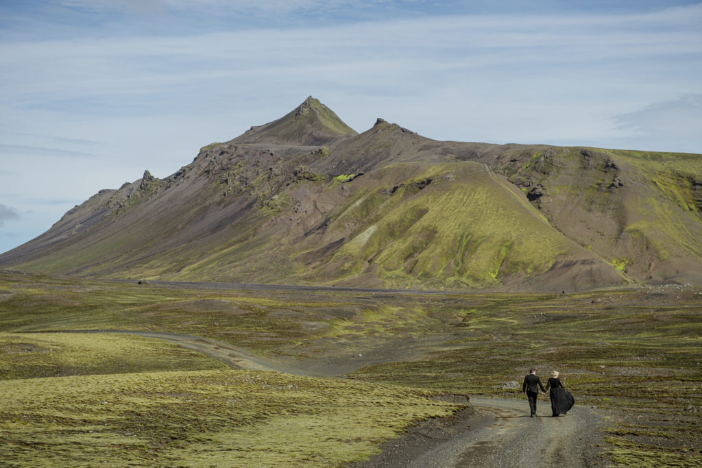 Couple walking in the Icelandic Highlands on their wedding day