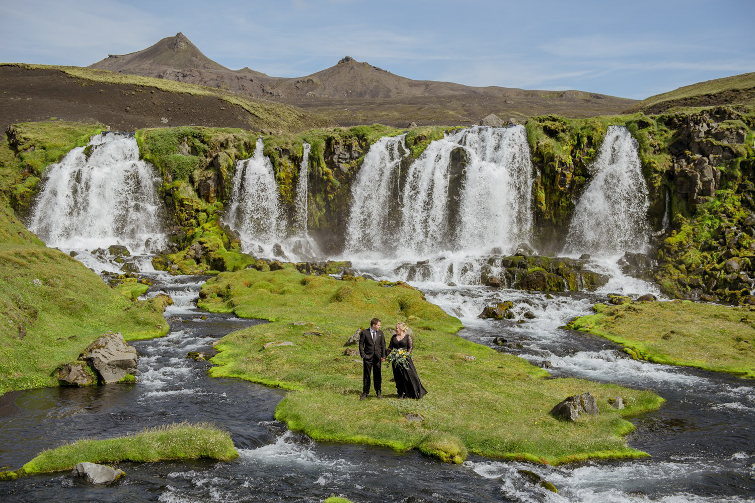 Couple at a waterfall in the Icelandic Highlands on their Iceland Elopement Day