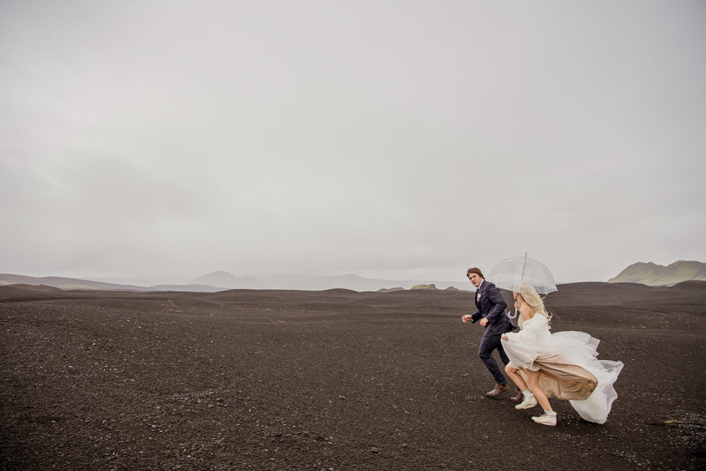 Cameron and Beau running on black desert in Iceland