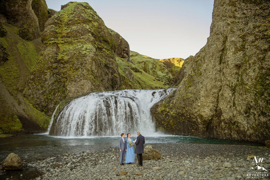 Eloping in front of a waterfall