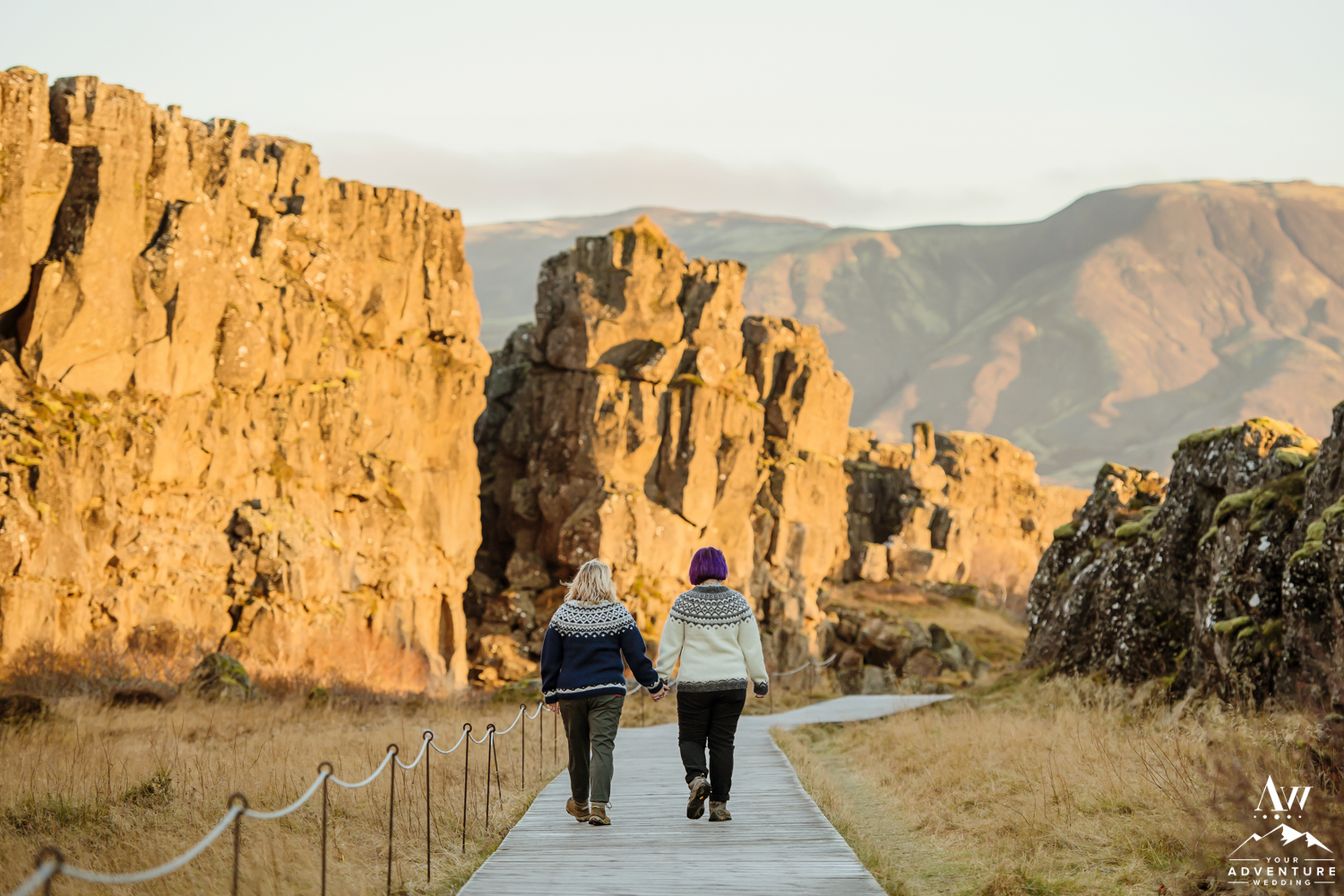 Couple Walking between Tectonic Plate after their Proposal