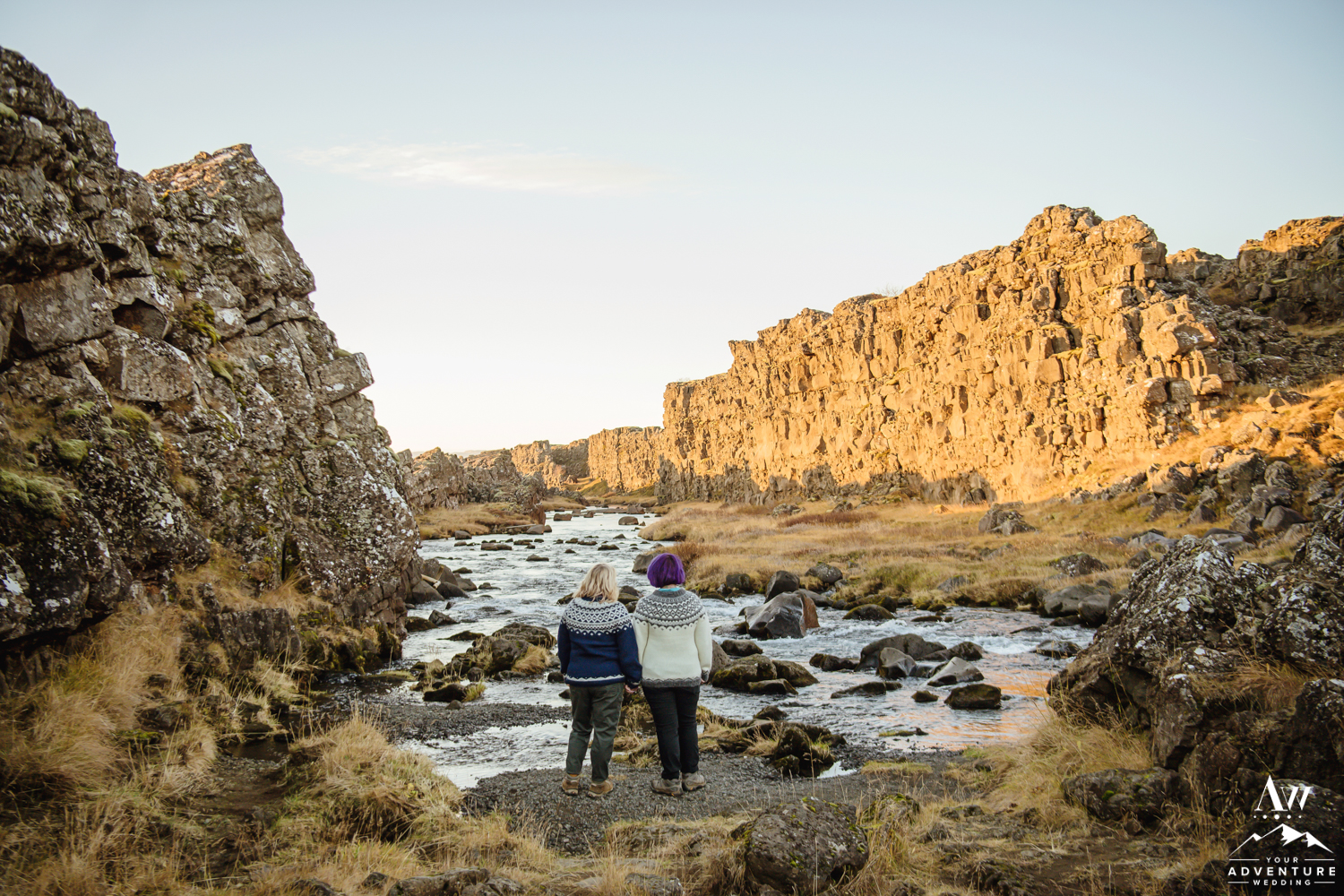 Couple between tectonic plates for engagement photos in Iceland