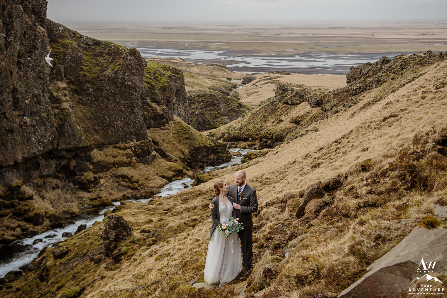 Iceland Wedding Couple Looking at Each other in Canyon