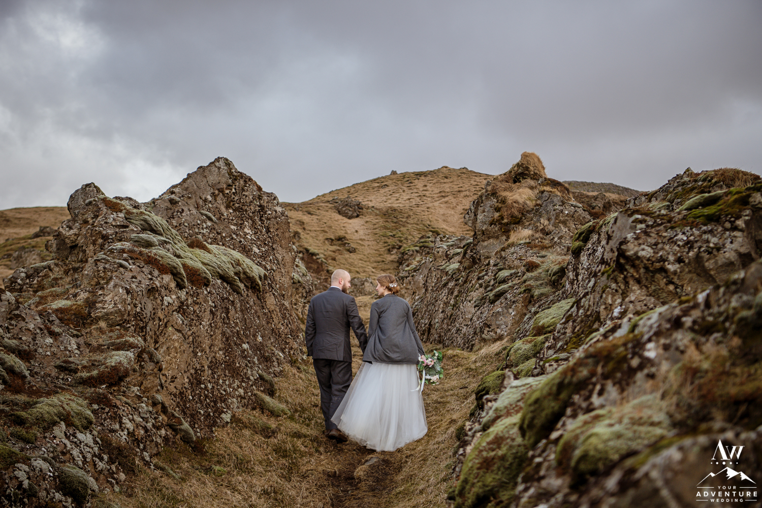 Iceland Elopement Couple Walking through Lava Path