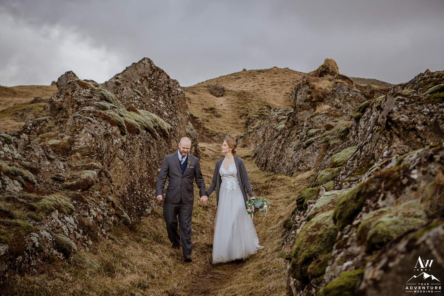 Iceland Wedding Couple Walking Through Laval Rock Walls