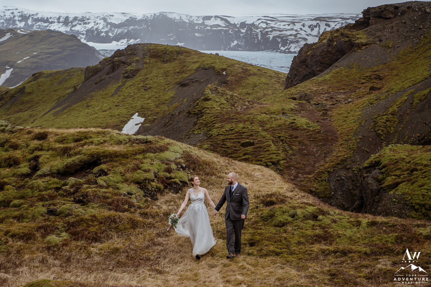 Couple walking on mountain during Iceland Elopement
