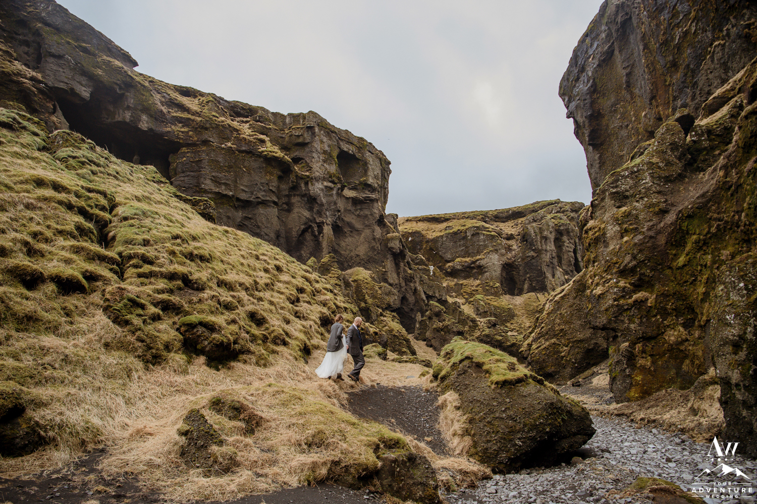 Adventurous Hiking Elopement Couple Hiking through a Canyon