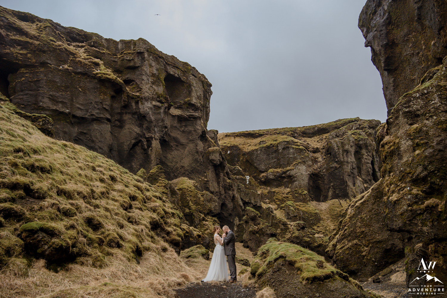 Hiking Elopement Adventure Couple being romantic in a Canyon