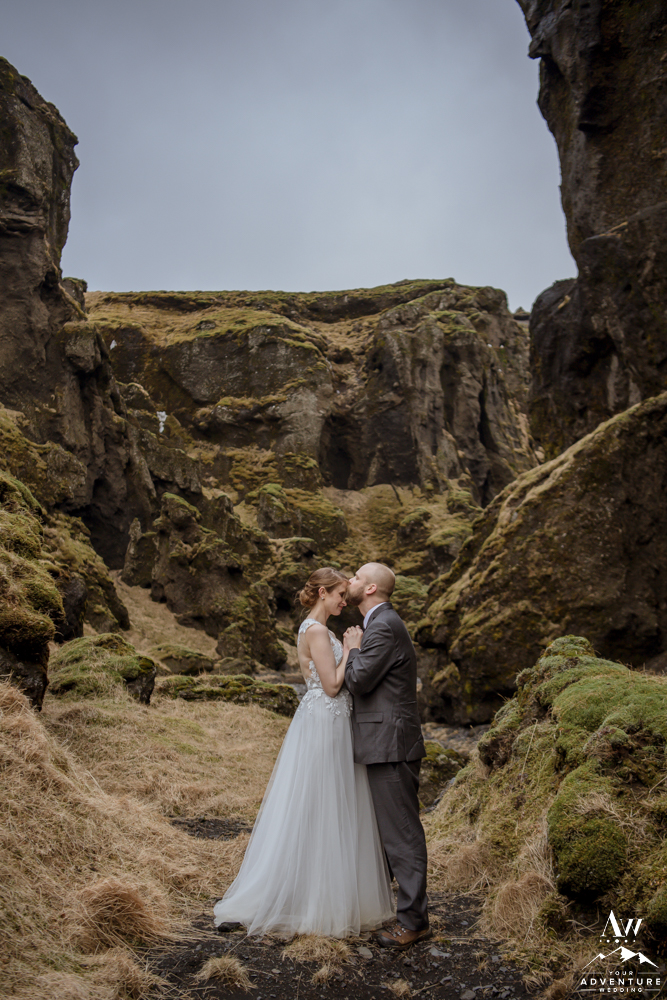 Groom Kissing his Bride during Iceland Wedding Day
