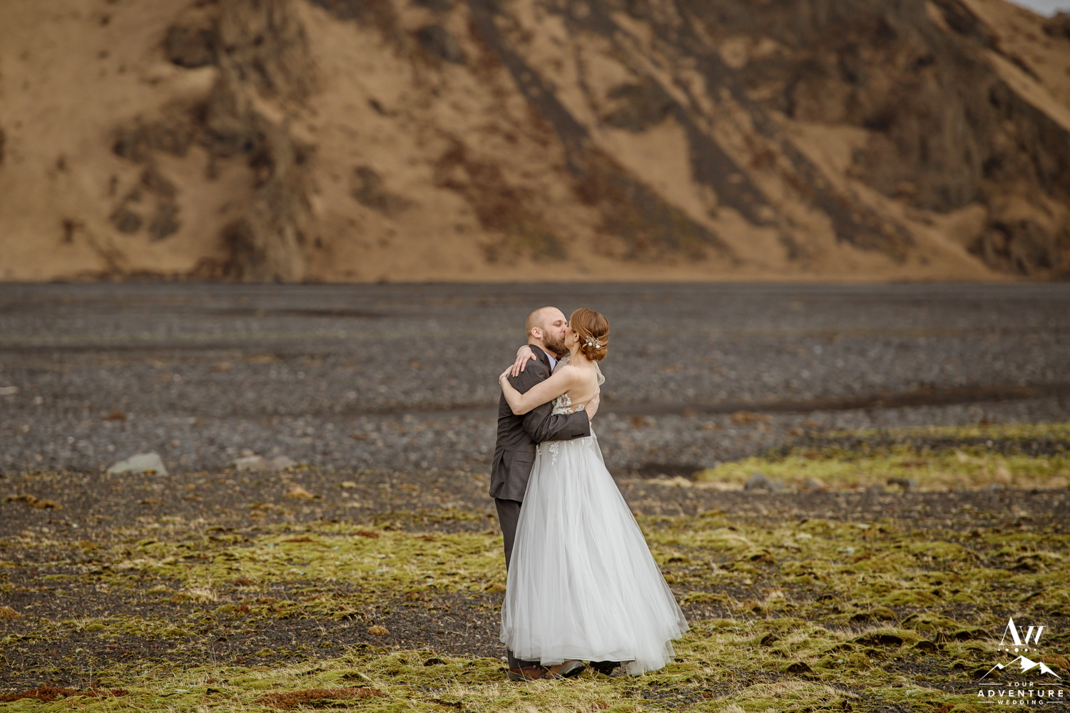 Couple kissing in front of a mountain in Thorsmork Iceland