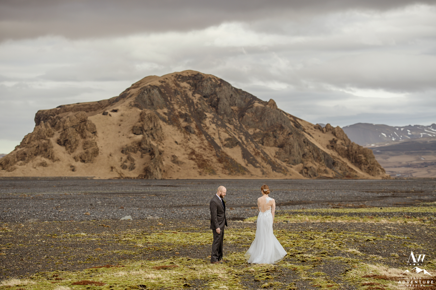 Bride showing her groom her Iceland wedding dress