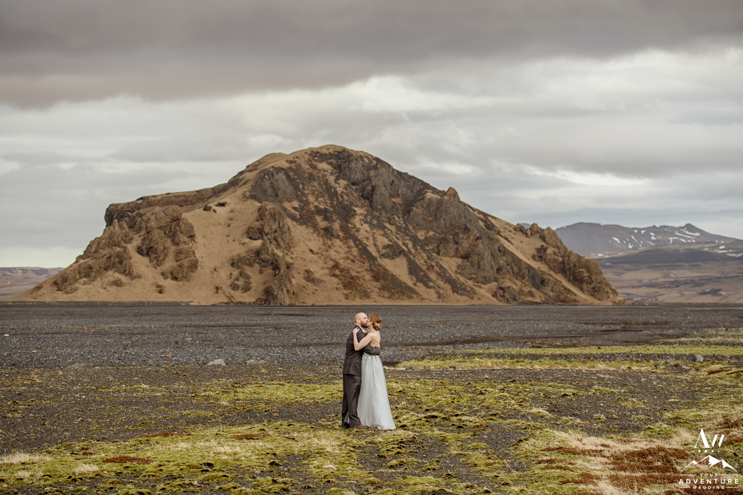 Iceland Wedding Couple Kissing in front of a mountain