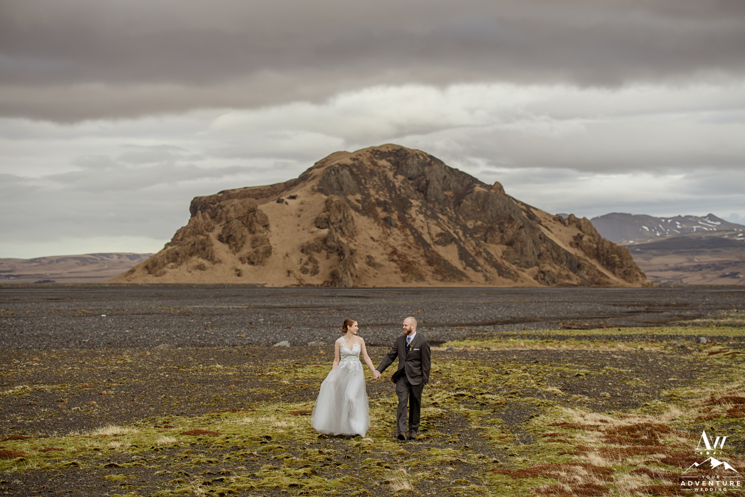 Iceland Wedding couple walking in front of a mountain