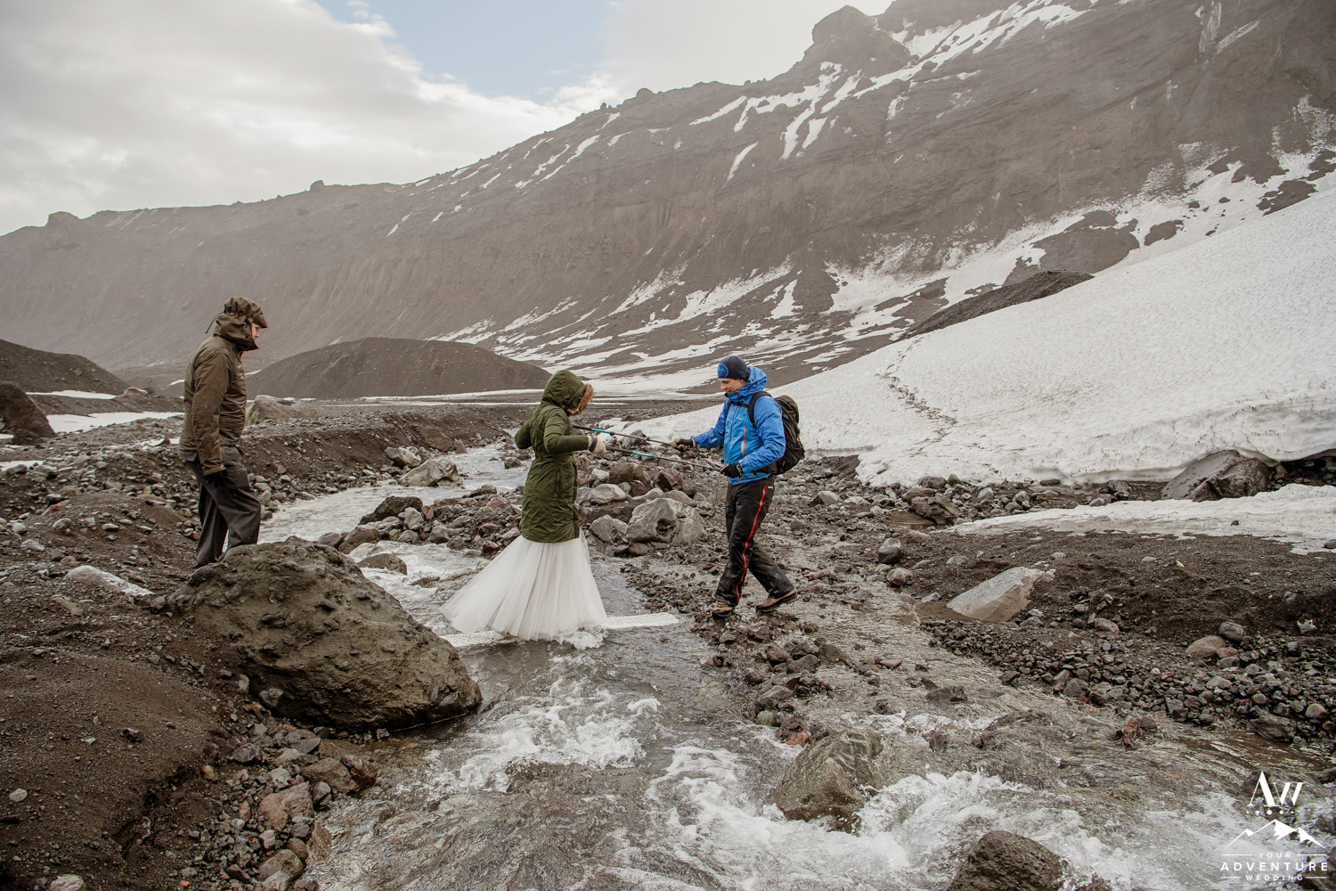 Bride Crossing a River Adventurous Hiking Elopement
