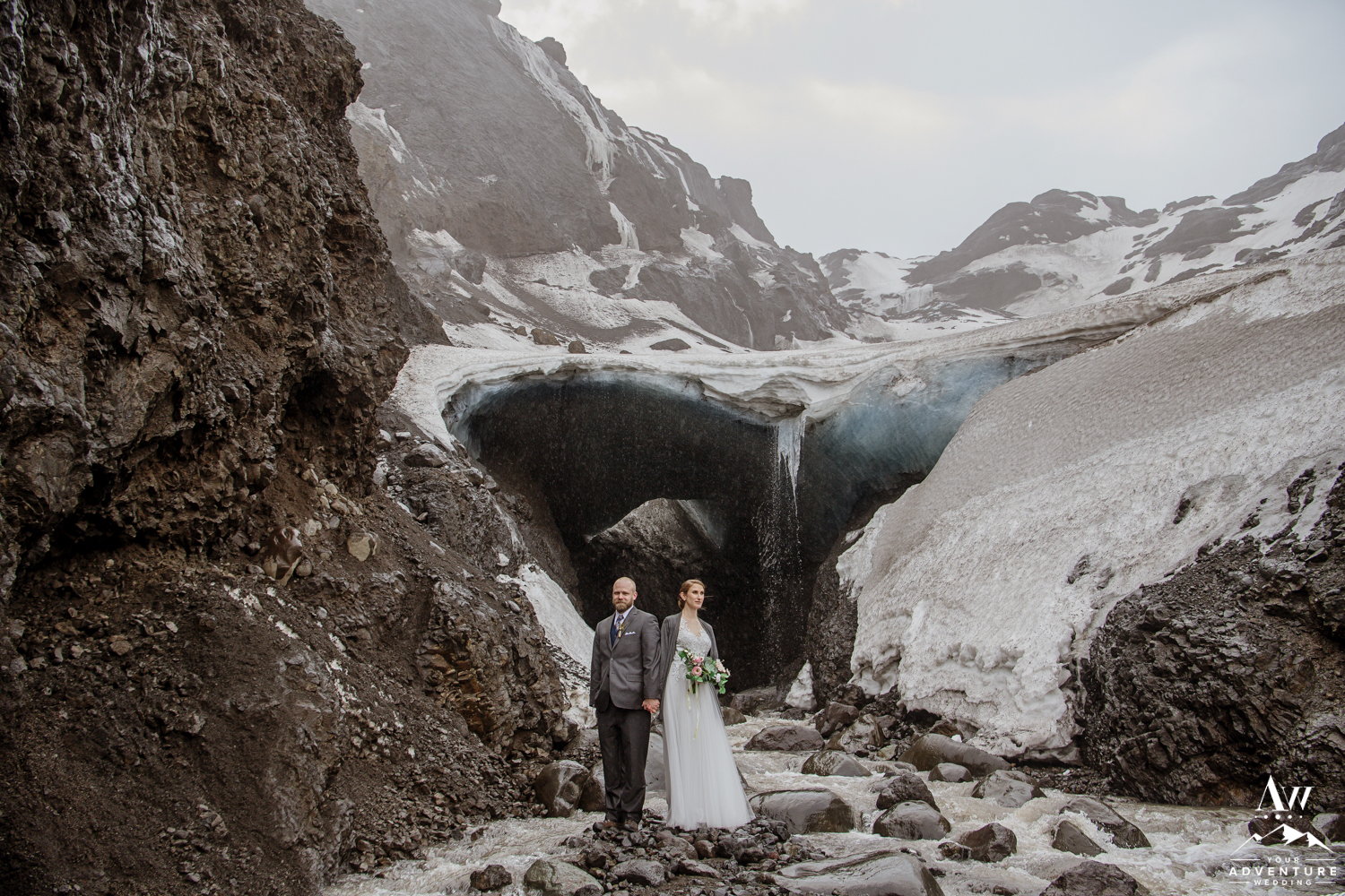 Wedding Couple in front of an Ice Cave in Iceland