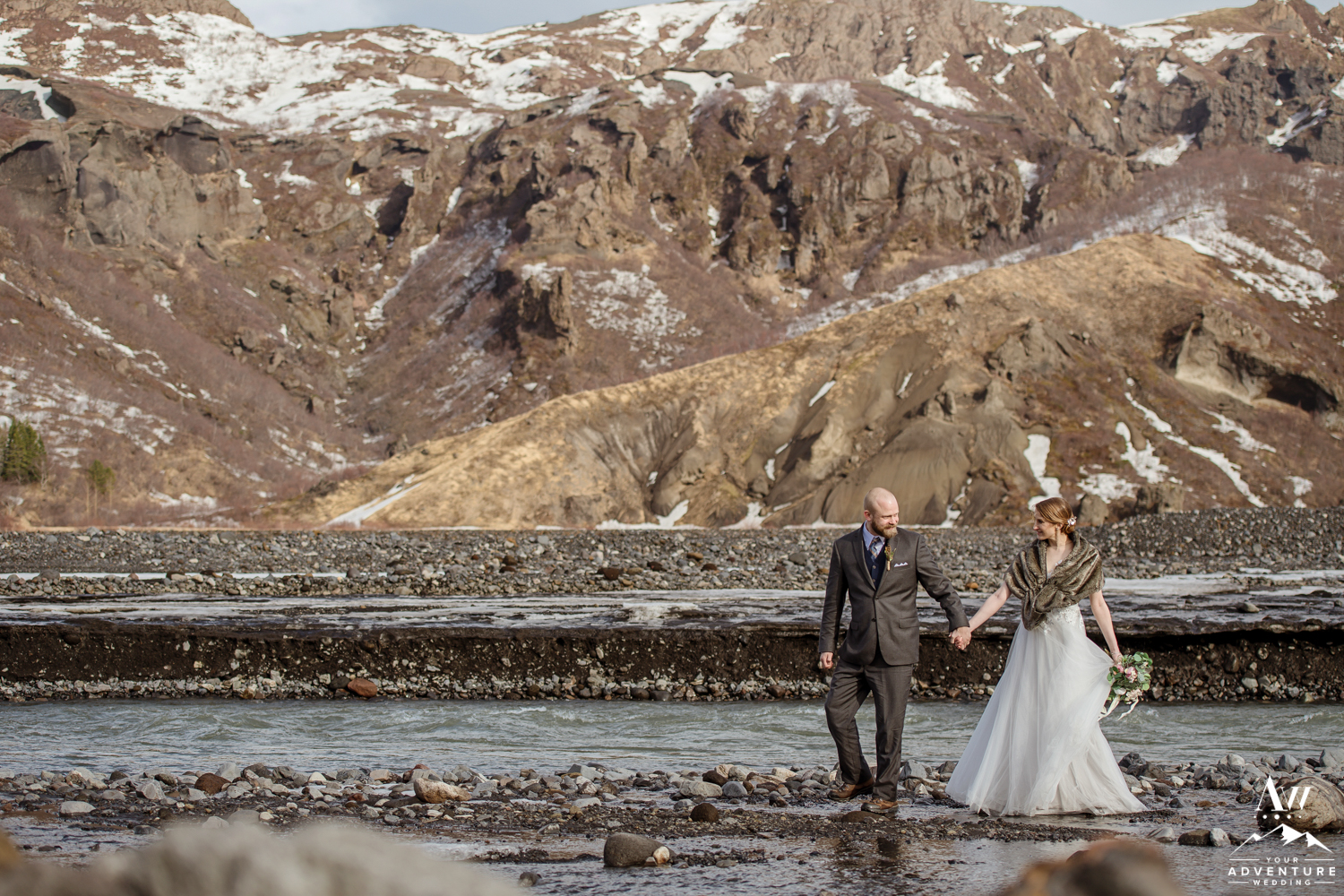Iceland Wedding Couple Hiking through a river in Thorsmork