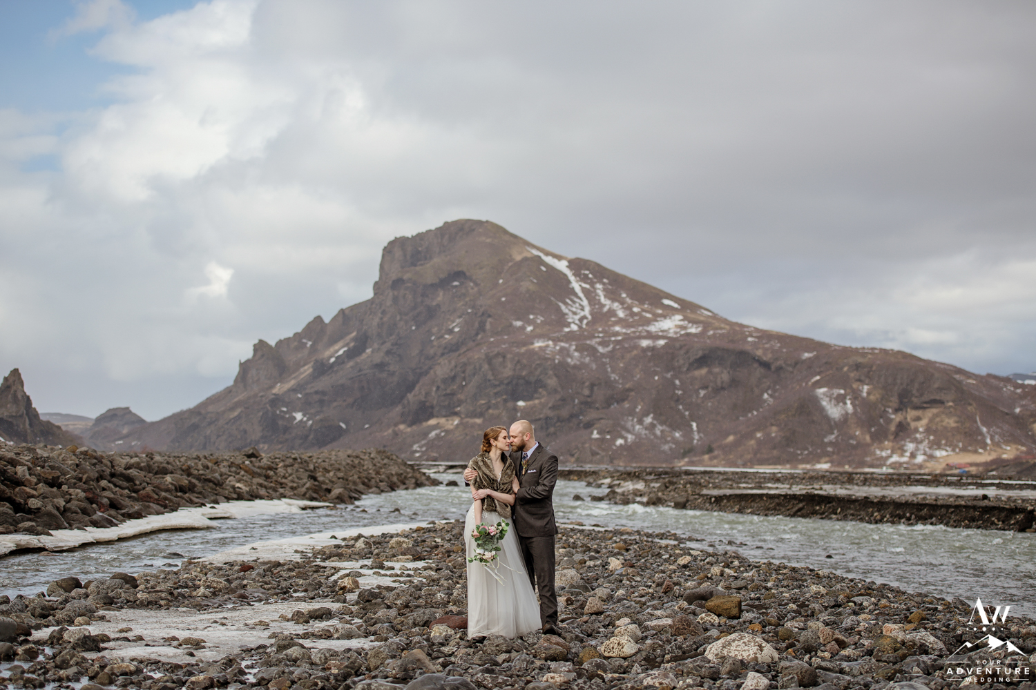 Adventurous Hiking Elopement couple standing in front of a mountain
