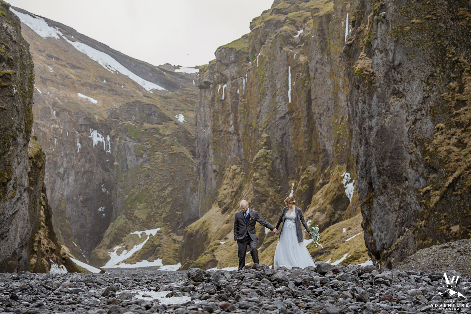 Couple walking inside of a canyon in Iceland