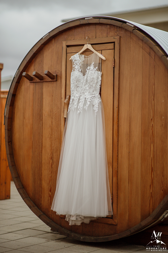 BHLDN Wedding Dress hanging on sauna Iceland elopement