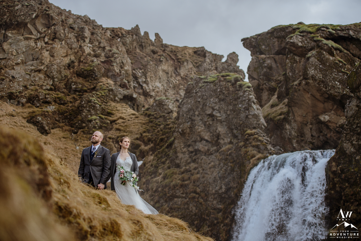 Adventurous Hiking Elopement couple in front of a waterfall