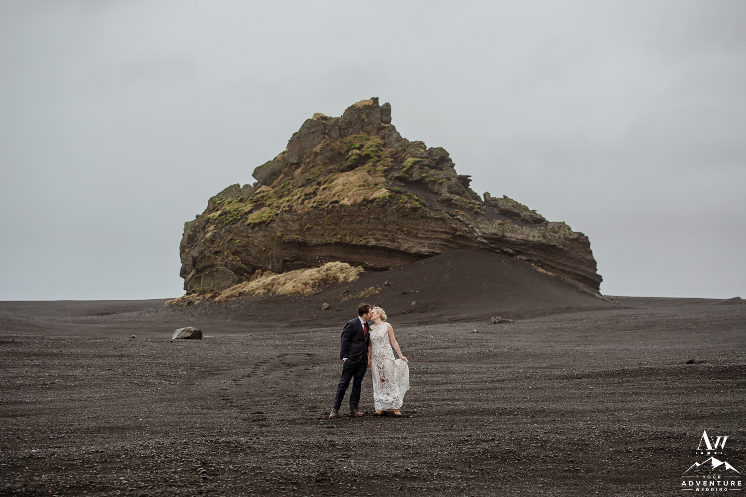 Couple Kissing on black beach in Iceland