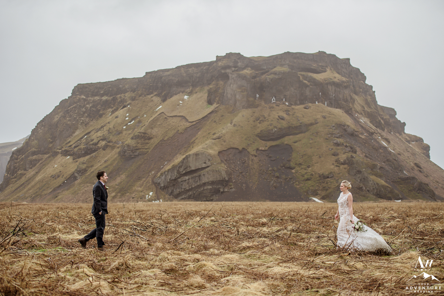 Couple in front of a mountain in Iceland