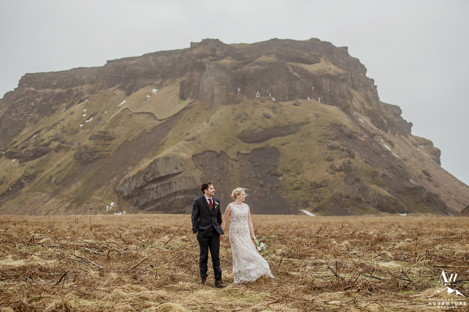 Wedding Couple Posing in front of a mountain