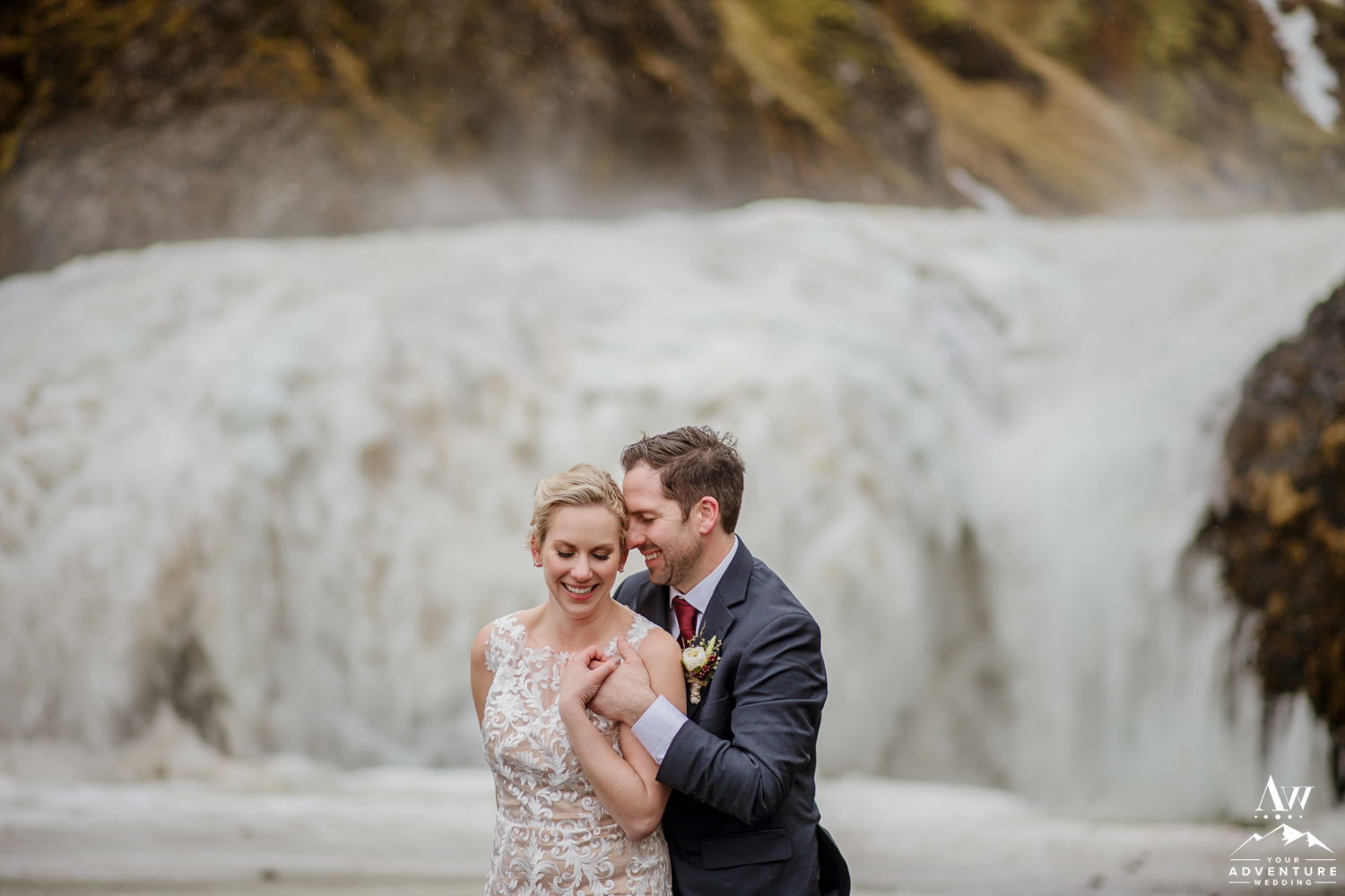 Intimate Iceland Wedding Portraits in front of a waterfall