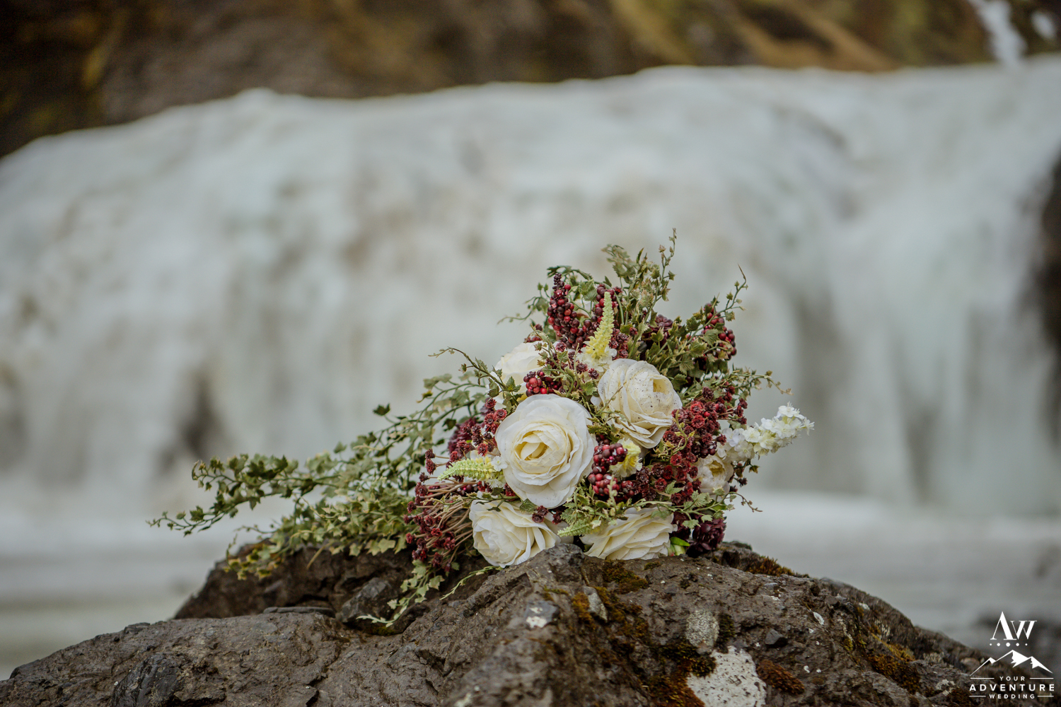 Iceland Wedding Bouquet in front of a frozen waterfall