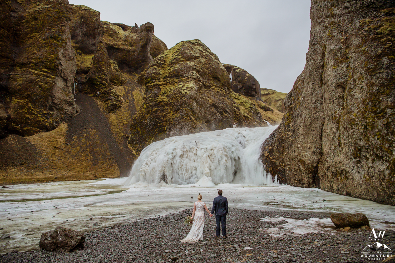 Wedding Couple in front of a Frozen Waterfall