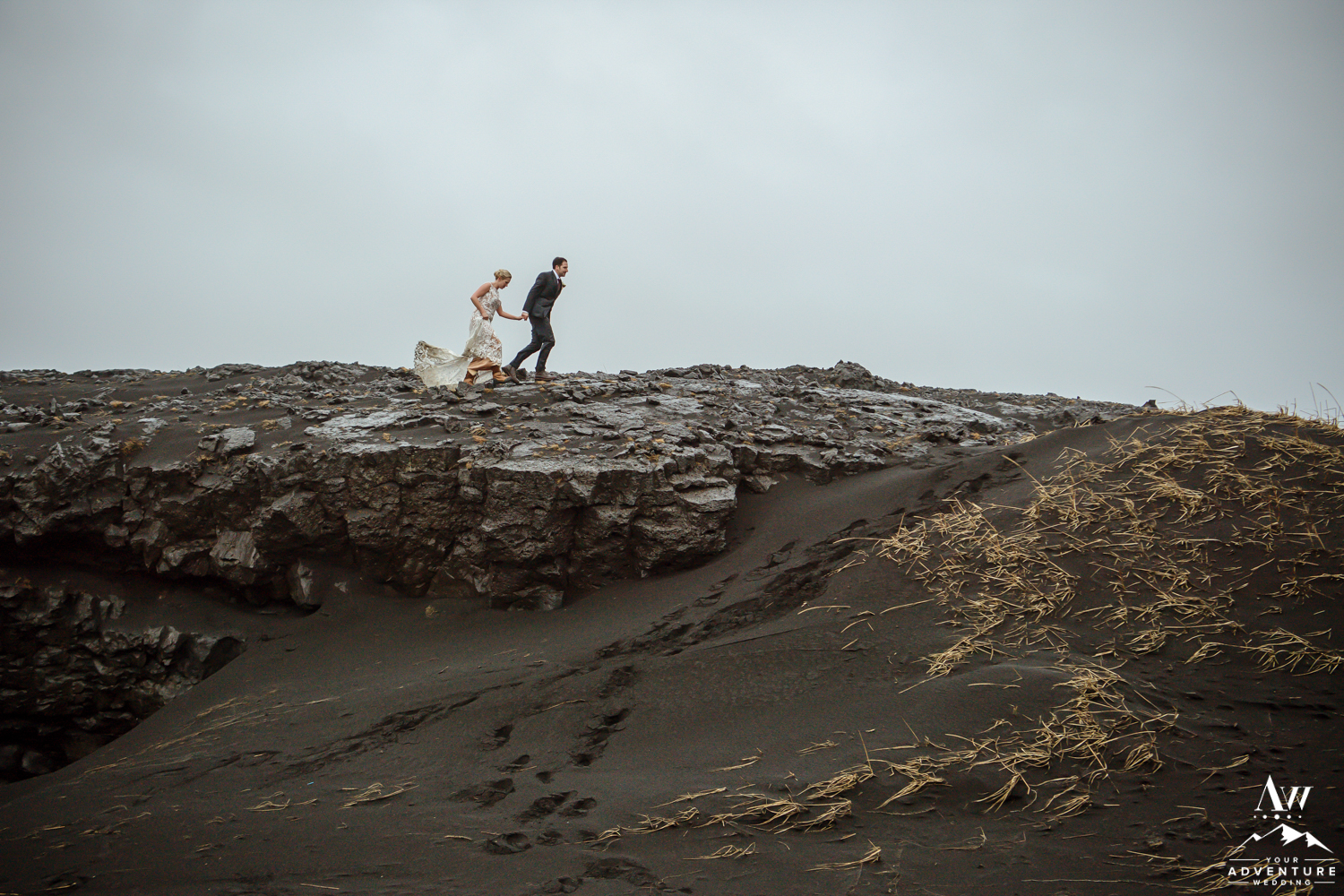 Couple walking on lava in Iceland