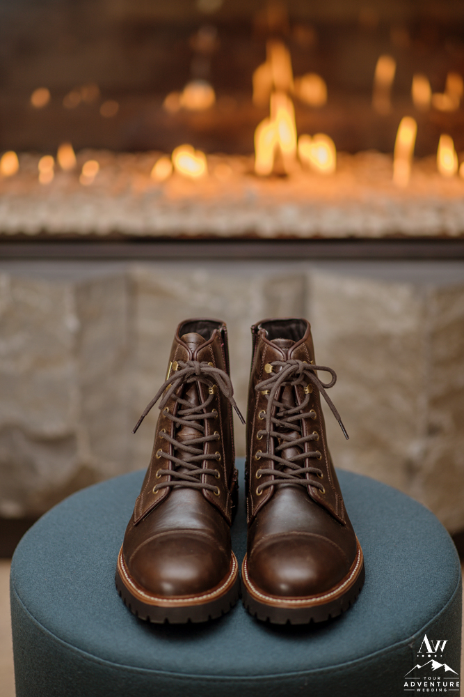 Iceland Elopement Boots in front of the fireplace