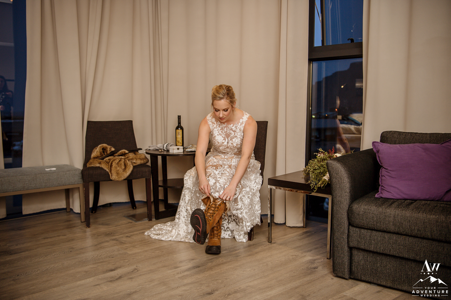 Bride getting her boots on before her Iceland Elopement