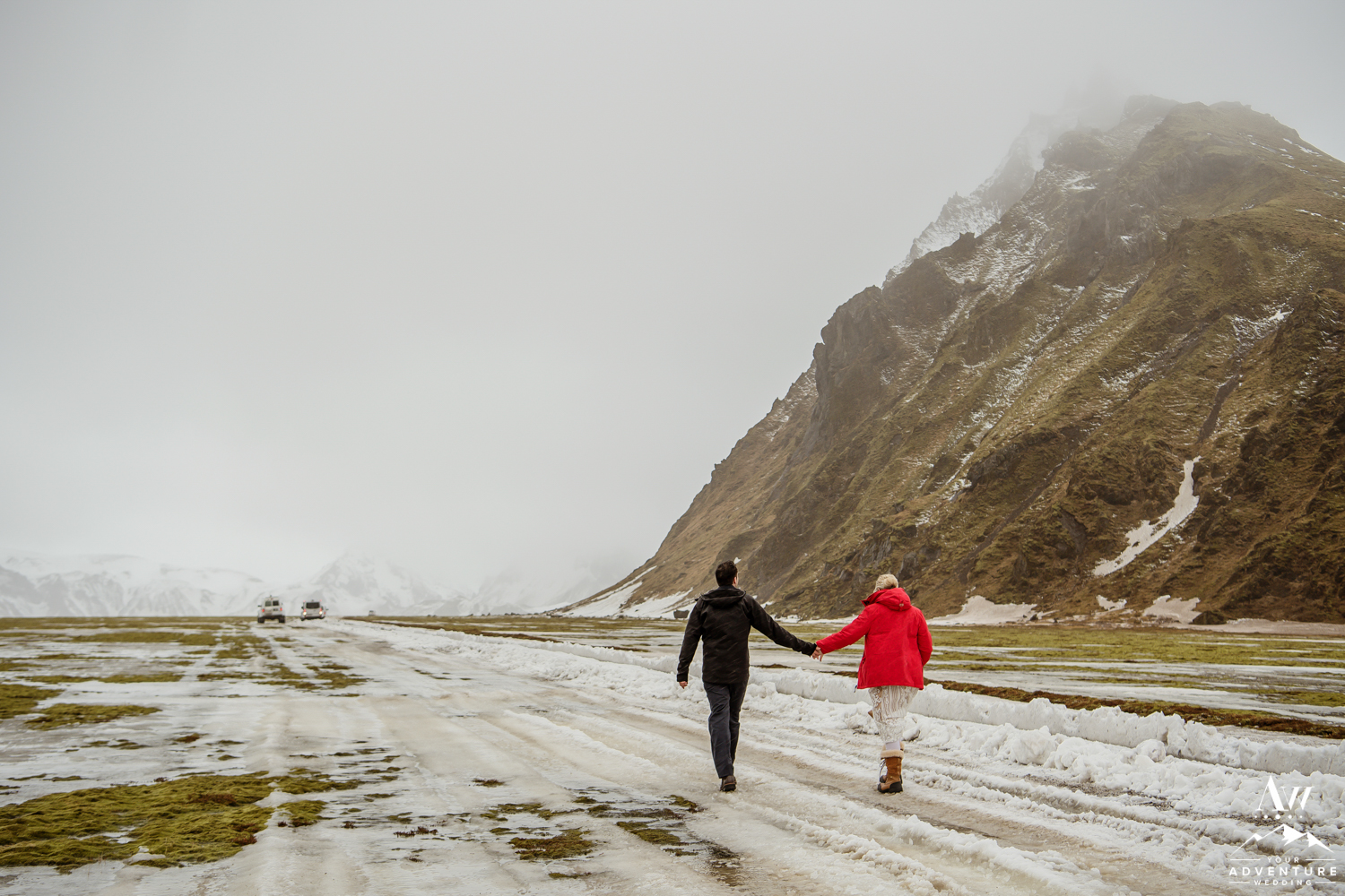 Couple walking in front of a mountain
