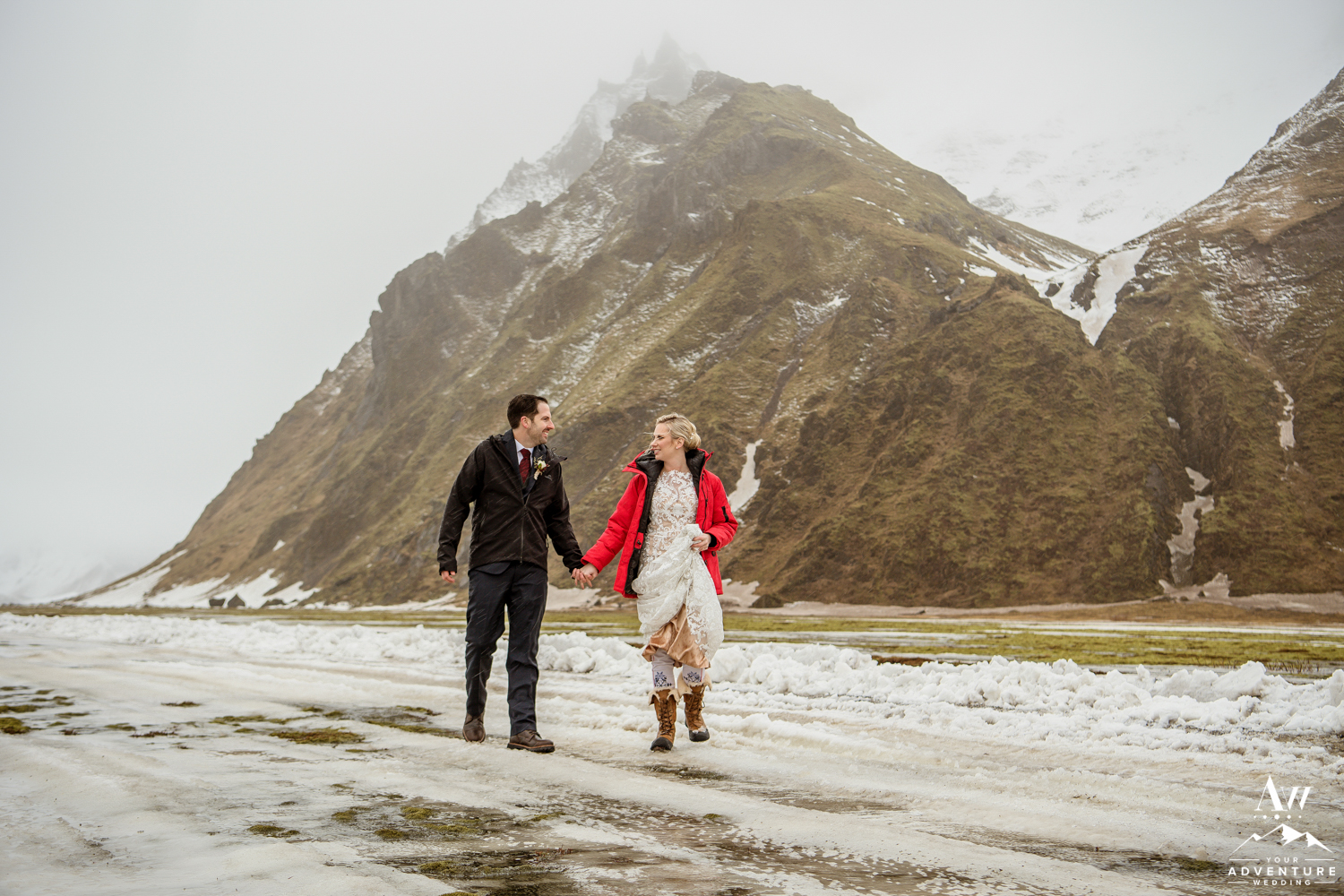 Couple Walking During Iceland March Elopement