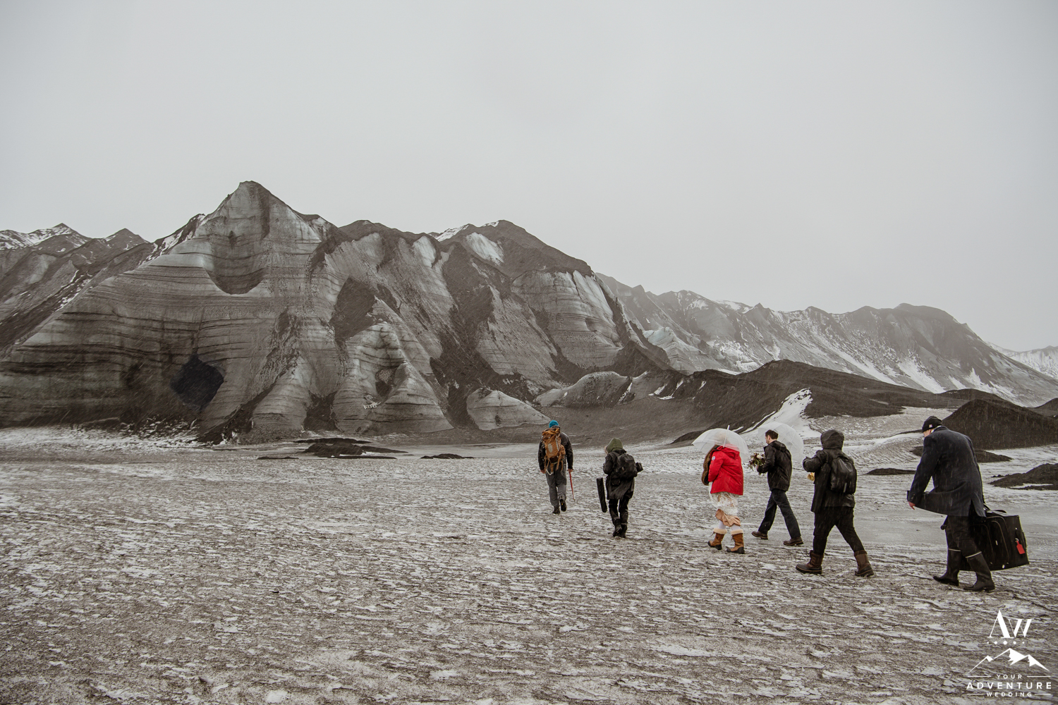 Group Walking to an Ice Cave for a wedding in Iceland