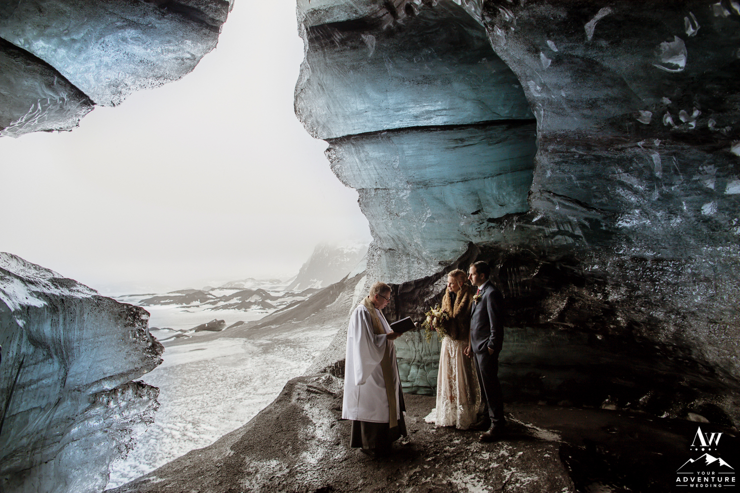 Couple inside of an Ice Cave for Wedding Ceremony