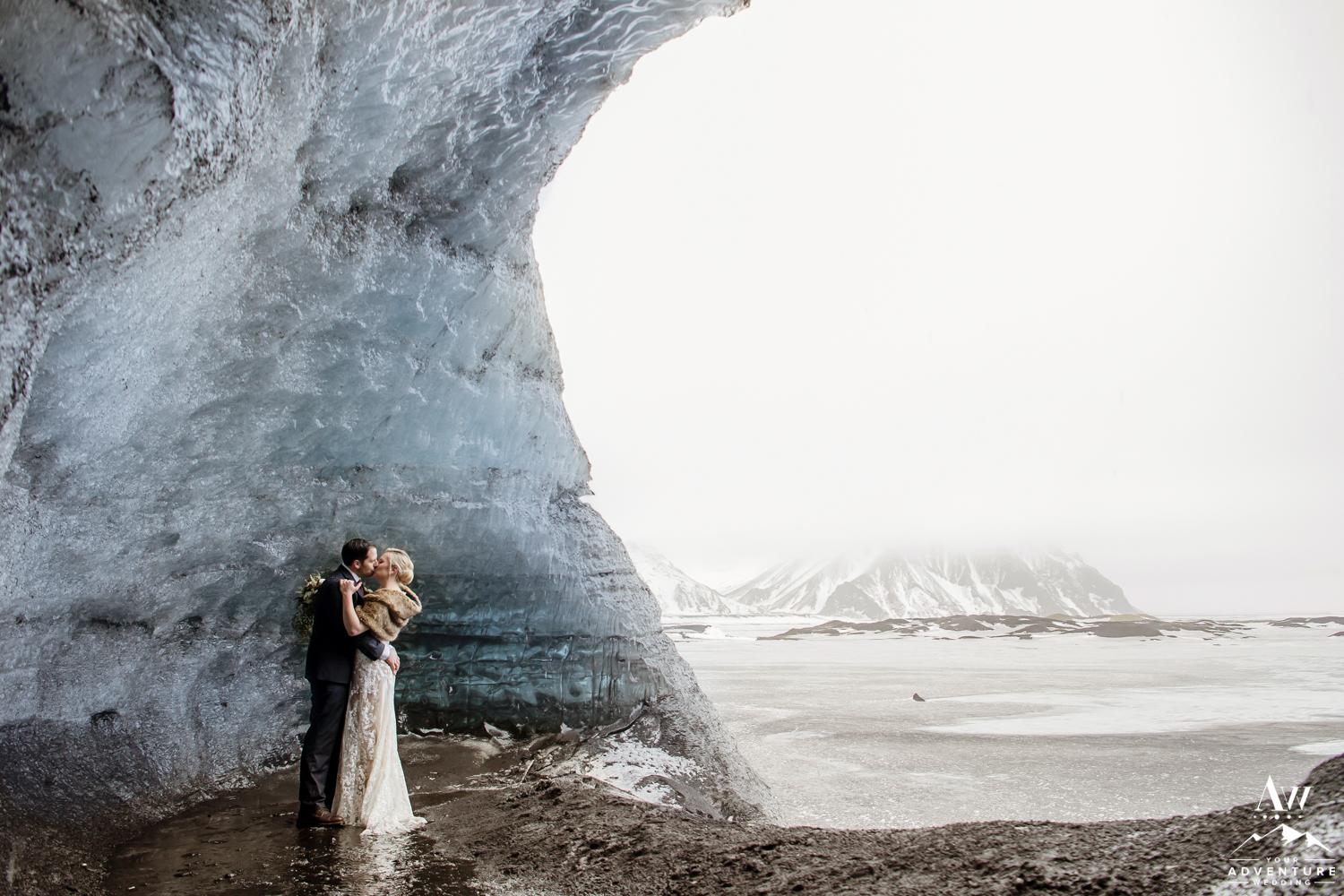 Wedding couple inside of an ice cave