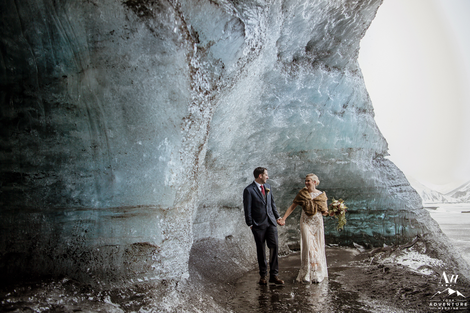 Couple Adventuring during Ice Cave Elopement
