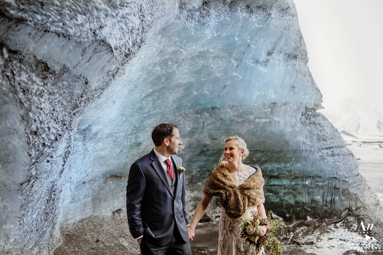 Wedding Couple laughing in ice cave