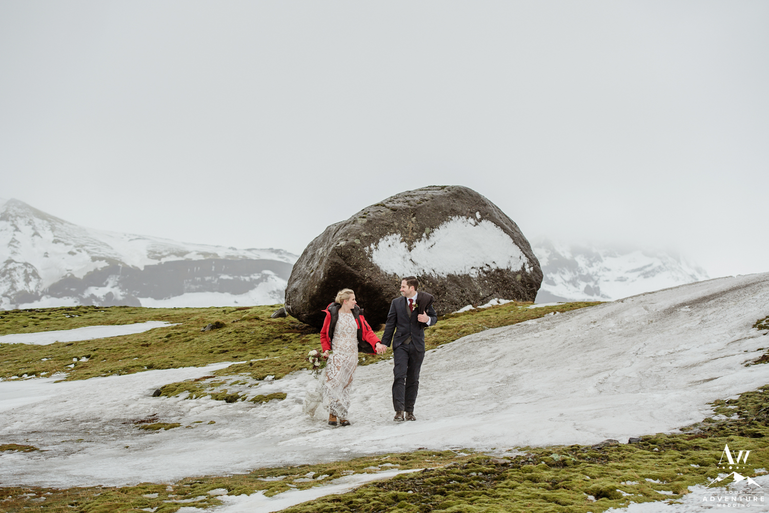 Couple walking on snow in Iceland