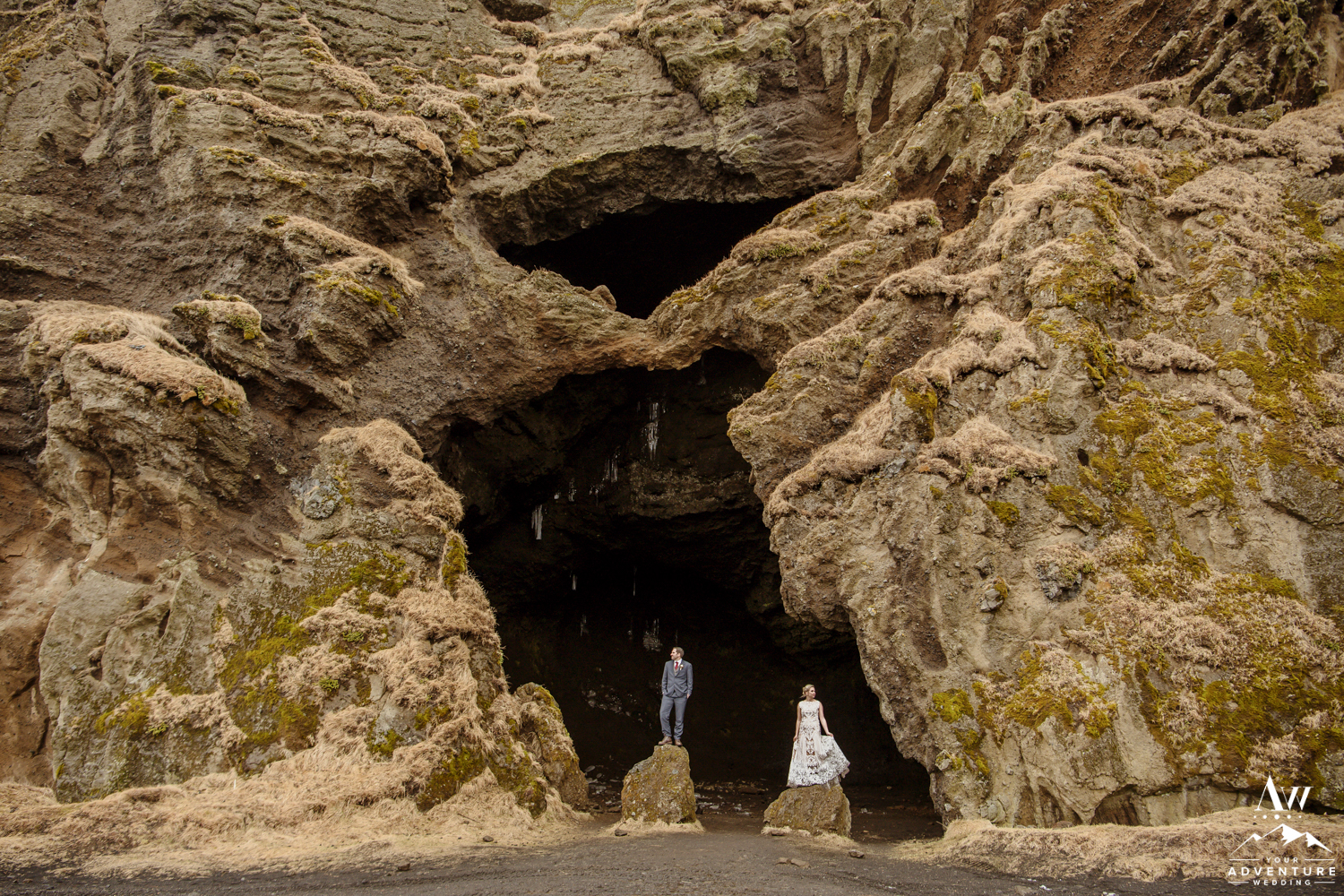 Couple on the outside of a cave in Iceland