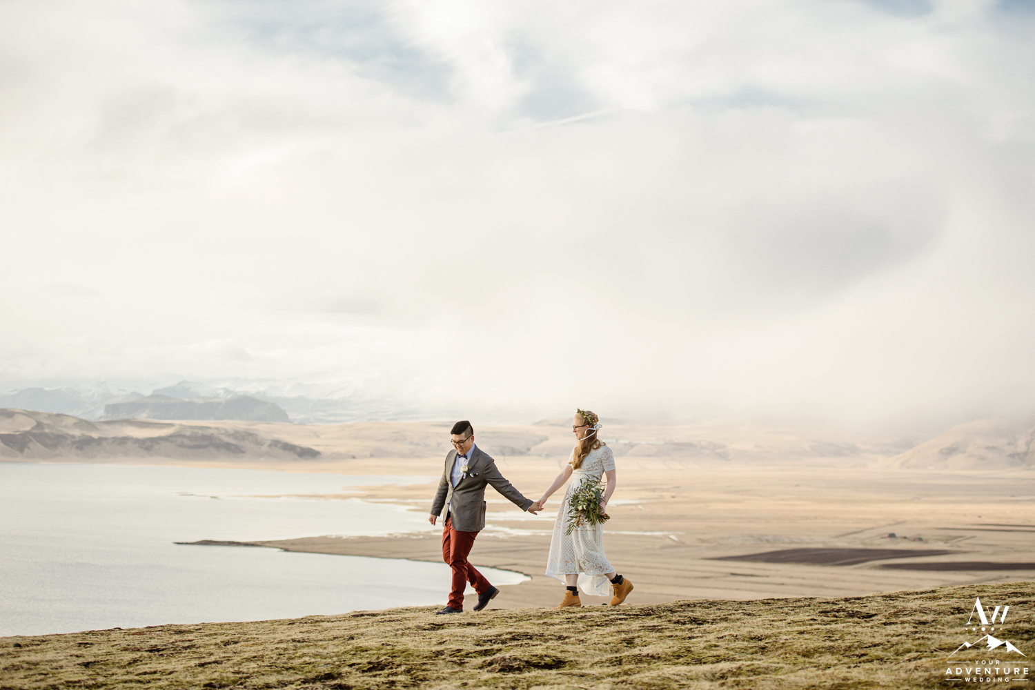 Groom adventuring with his bride on Iceland mountain