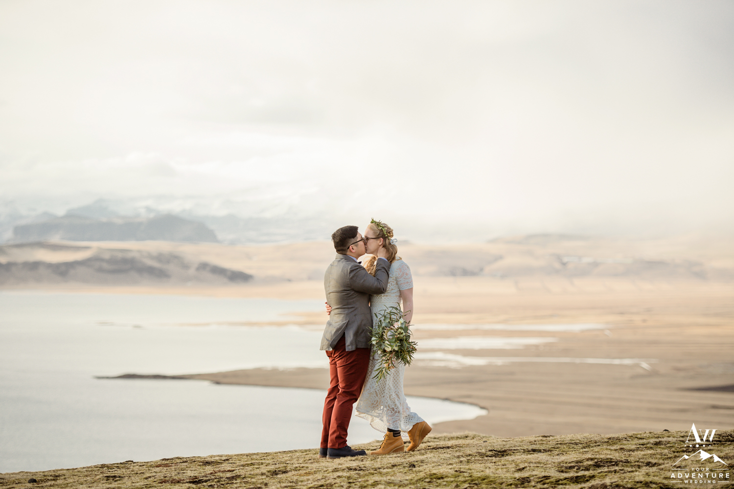 Couple kissing on their Iceland wedding day on a mountain